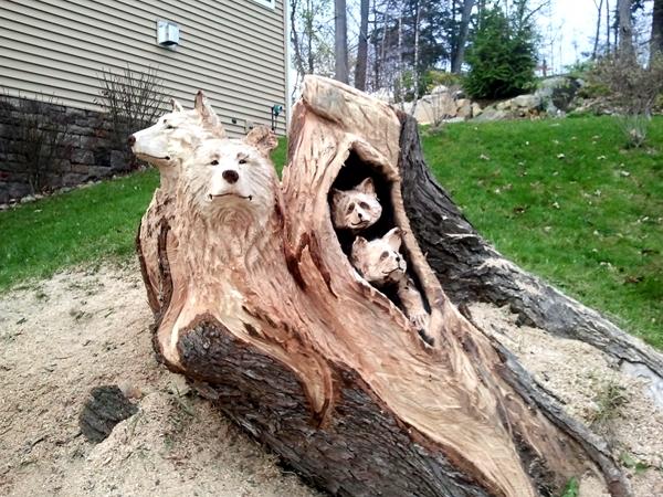 Beautiful yard art from old tree logs.